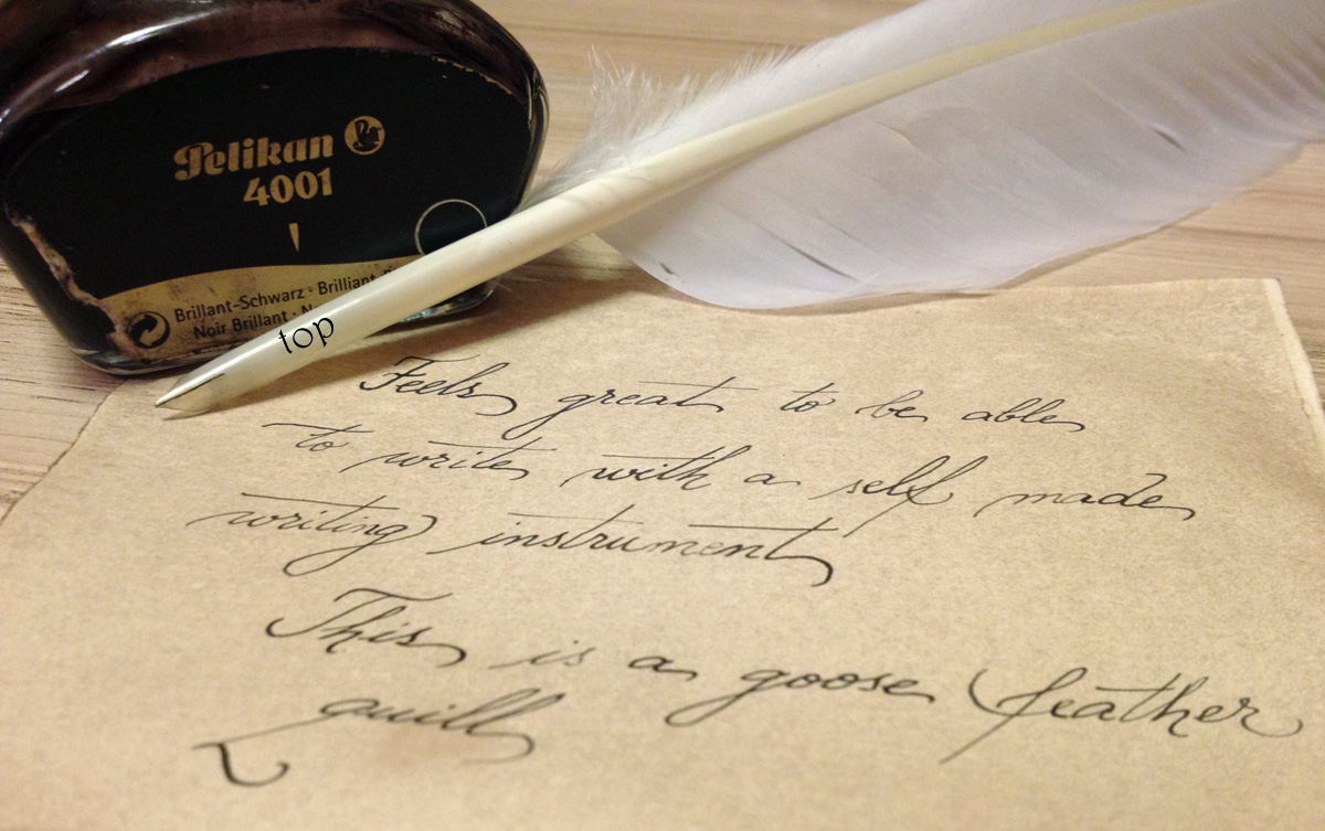 writing with a feather quill pen