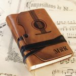 The-Violin-leather-journal-with-vintage-style-paper-in-orange-brown